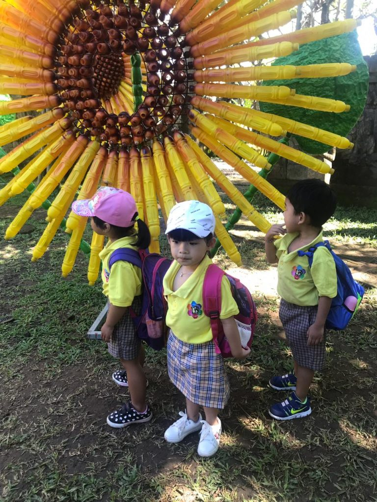 kids in front of sunflower
