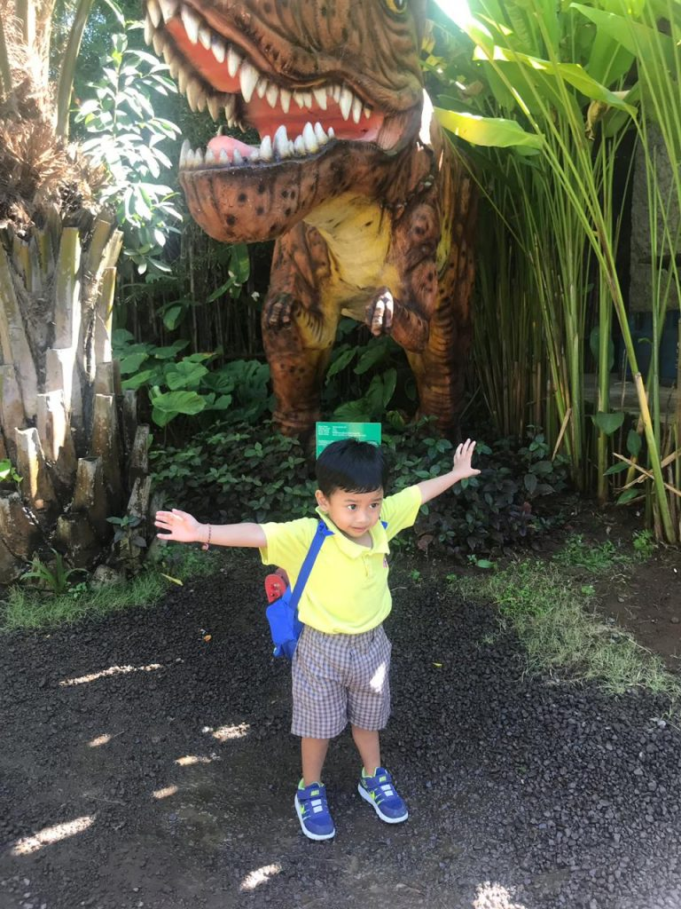 in front of dinosaur